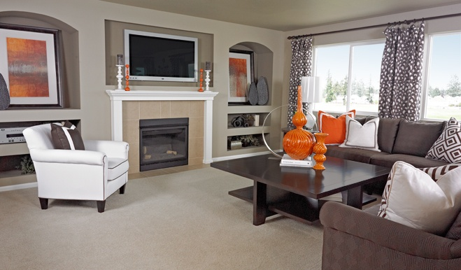 Orange Accessories Add A Dramatic Pop Of Color To This Neutral Living Room In Wa Living Rooms
