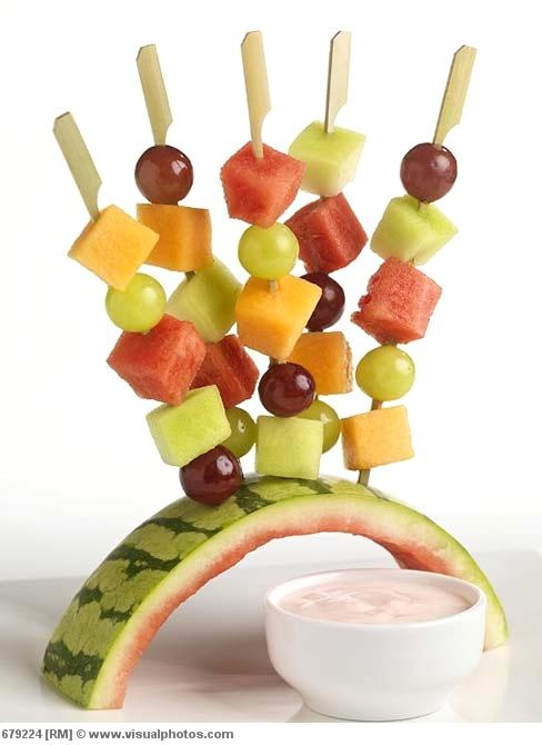 fruit skewers on watermelon rind...refreshing...i might have to add blueberries...strawberries...ok...