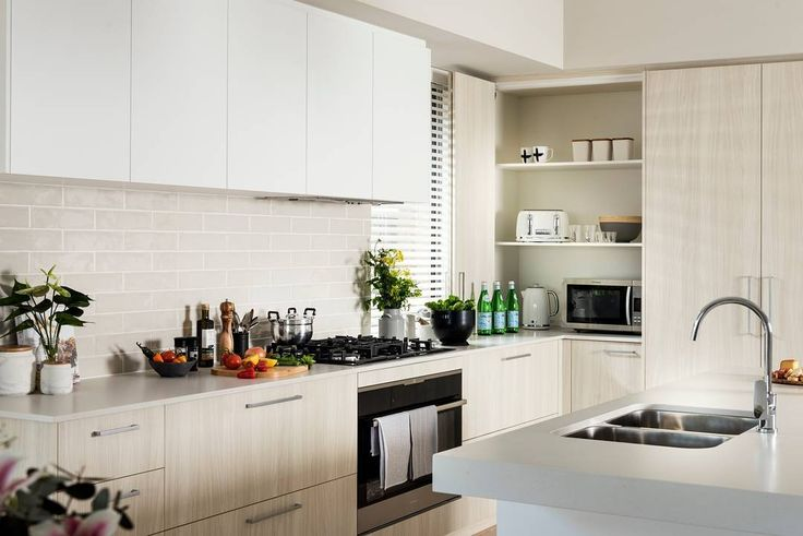 Summer is a time to entertain and be merry, and we all know how entertaining centers around the kitchen. This one from @dalealcockhomes uses subway tiles effectively with beautiful light timbers. Choose a tall gooseneck mixer like this Posh Solus sink mixer to make cleaning those clunky, big pots a touch easier!