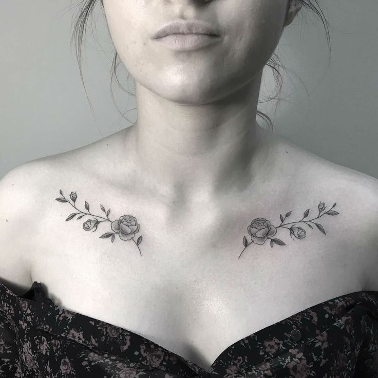 Symmetrical tattoos with thin lines and soft roses.