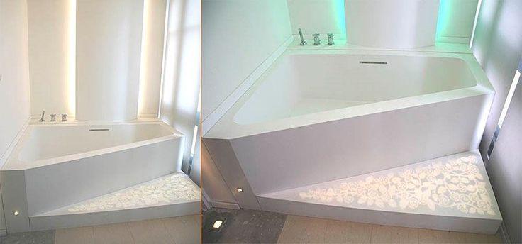 Bañera poligonal a medida con suelo retroiluminado realizada en LG Hi-Macs®. Diseño exclusivo.