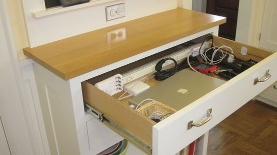 cool built in charging station drawer..i hate having all the electronics on counter tops and tables for everyone to see.