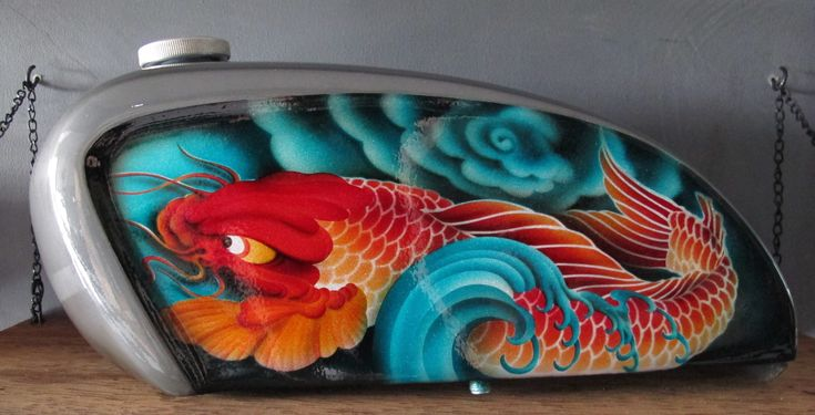 Hand shaped airbrushed tank  #motorcycle tank #airbrush tank #airbrush motorcycle tank #tattoo art #koi tattoo art #japanese koi #koi airbrush #bali #motorcycle parts #custom motorcycle parts #custom motorcycle gas tank