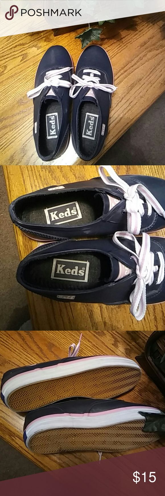 Women's Navy Blue KEDS Tennis Shoes 6 M This is a nice pair of Keds.  Washes right off with the  Rubber like material says Faux Fur.  Pretty dark blue with white amd pink striped shoe laces.  Bottom of shoe is also pink and white striped. Keds Shoes Athletic Shoes