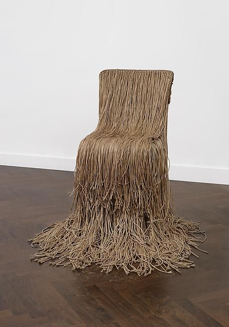 Gunther Uecker, String Chair, 1969  kitchen chair with back and seat cover with long strings pulled through holes  34 1/4 x 16 1/8 inches