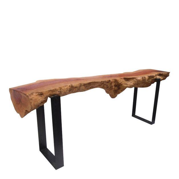 Eines der beeindruckendsten Möbel unserer Kollektion. Ein halber massiver Baumstamm aus Teak, gebettet auf Eisenträgern. L/B/H: 247x45x90 cm, 175kg