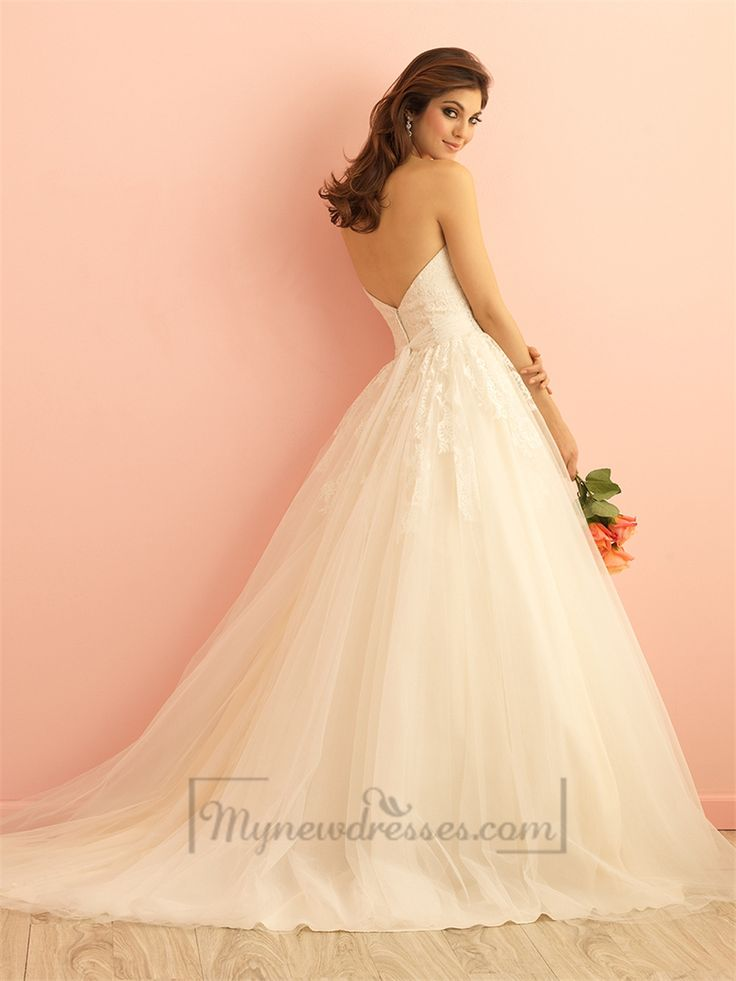 This exquisite ballgown is topped with lace appliques and finished with a subtly beaded sash.