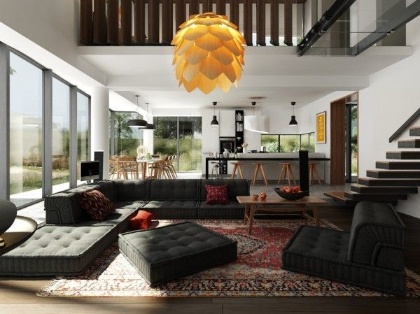 The cool modular sofa is a focal point in this spacious, airy home. Cushions can slide any which way, creating plenty of space for lounging, napping, or just sitting if you want to be boring about it.
