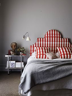 """Haymes paint colour MEMORY. """"Create a welcoming, snug space by introducing a warm, grey tone, like Haymes Memory. Prepare for the cooler months by layering knitted throws and piling on the pillows in contrasting colours. Add a touch of drama with a statement bedhead that demands attention and instant admiration."""""""