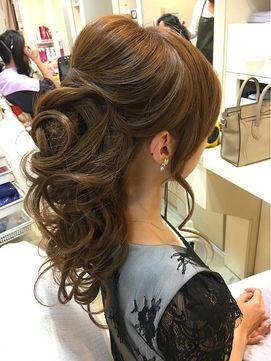 重い巻き髪