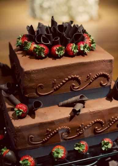 Chocolate wedding cake with strawberries // Photo by Traina Photography. #cake #wedding #chocolate