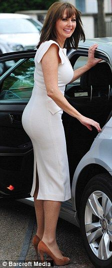 Carol Vorderman struggles as she tries to get in her car in a super-tight pencil dress   Daily Mail Online