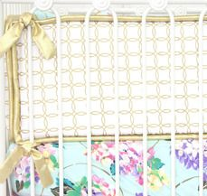 Caden Lane has gold and white crib bumpers, these circles interlock and could be used for boy or girl.