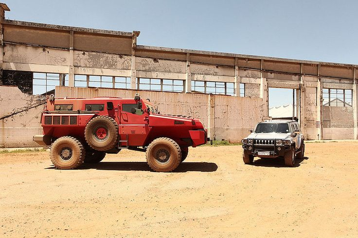 The Marauder, a totally street legal South African military vehicle. The other car in this picture is a Hummer. This thing can climb over other cars and drive through brick walls.