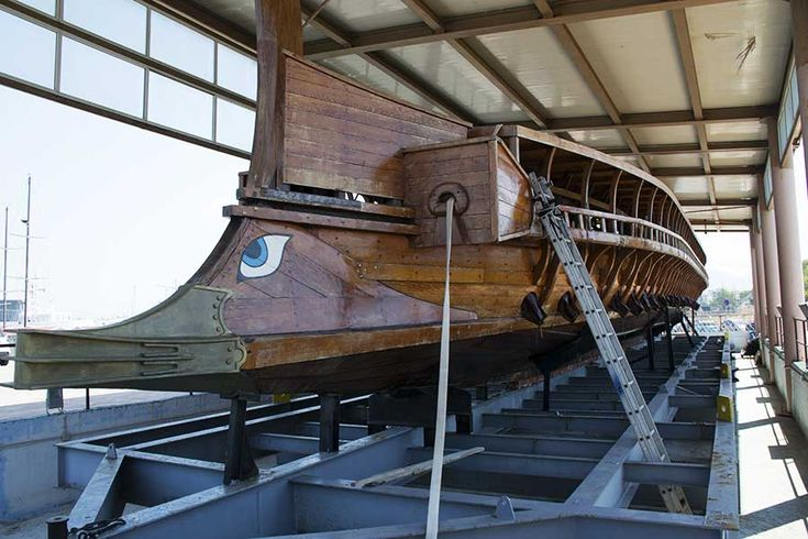 "The ""Olympias"" is an exact replica of the ancient Greek trireme. Her construction was completed in July 1987. Initially the trireme was used to determine her sailing characteristics, her strength and the battle tactics and living conditions inside the vessel. . Read more at greekvoyager.com"