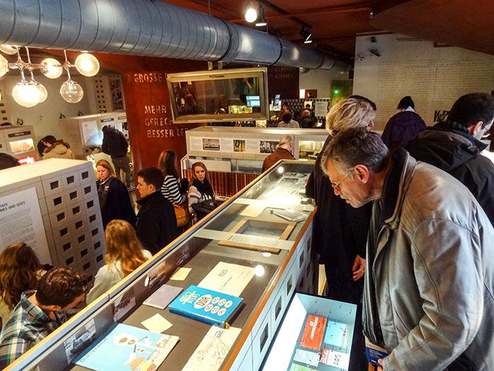 people looking at exhibits in the DDR Museum, one ofThe Best Things To Do In Berlin, Germany