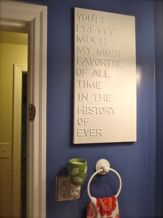 Custom Quote Art - Glue letters onto Canvas then spray paint entire piece in one color. Simply beautiful. Use high gloss paint for added elegance.