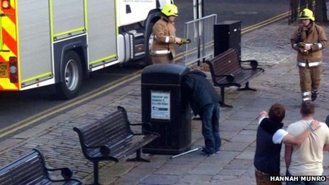 Man with head stuck in bin had lost his hat!