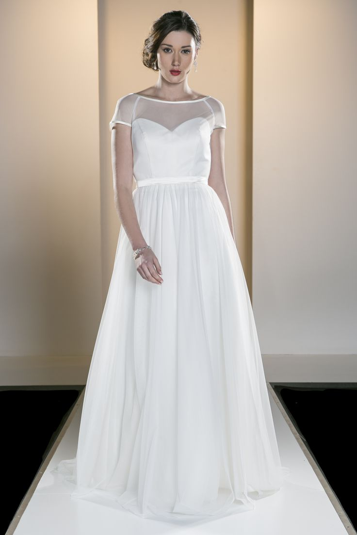 OCA 567T 'Laura' A classic and chic all over tulle gown with sheer bodice detail over the shoulders and a full gathered skirt.