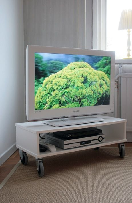 Make this tv stand: http://chezlarsson.com/myblog/2011/08/the-tv-unit.html