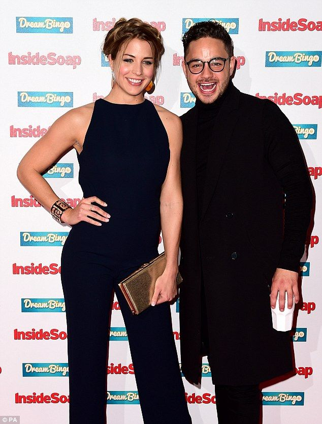 Having a blast: Gemma Atkinson and Adam Thomas enjoyed a joke as they took to the red carp...
