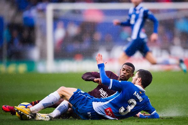 Nelson Semedo of FC Barcelona fights for the ball with Aaron Martin of RCD Espanyol during the La Liga match between Espanyol and Barcelona at RCDE Stadium on February 4, 2018 in Barcelona.