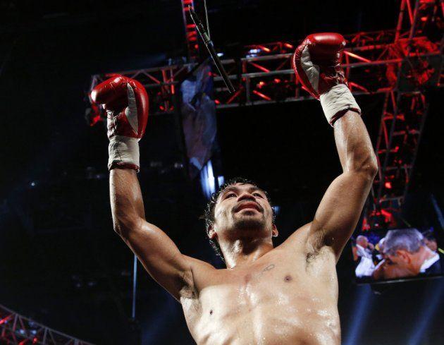 El filipino Manny Pacquiao celebra luego de derrotar a Timothy Bradley en un combate por el título wélter de la Organización Mundial de Boxeo, el sábado 9 de abril de 2016 en Las Vegas (AP Foto/John Locher)