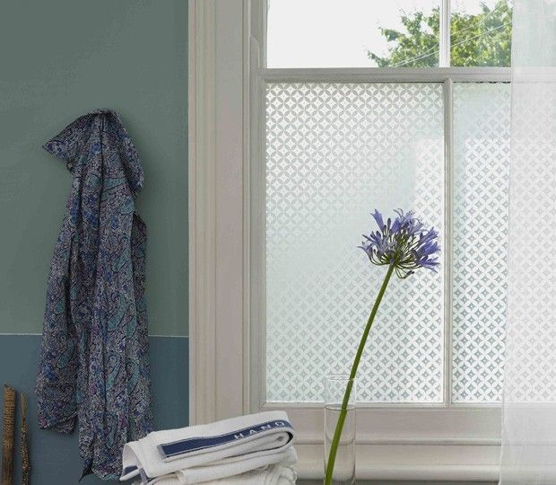 A Victorian-esque pattern could be used to obscure the glazing rather than it being fully frosted.