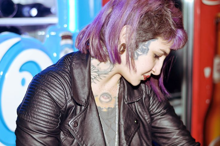 Purple hair & undercut with face and neck tattoos !