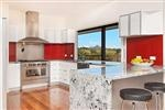 Kitchen with view to ocean and Mt Chingogan xxx windows opening out onto entertaining area