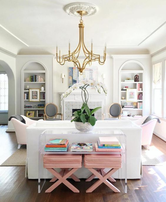 White & blush pink - x benches beneath lucite sofa table -