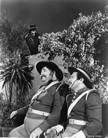 Zorro (Guy Williams) overlooks Sergeant Garcia (Henry Calvin) and Corporal Reyes (Don Diamond).
