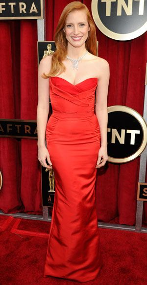 Who says redheads can't wear red? Nominee Jessica Chastain wowed in a scarlet Alexander McQueen gown and Harry Winston diamonds.
