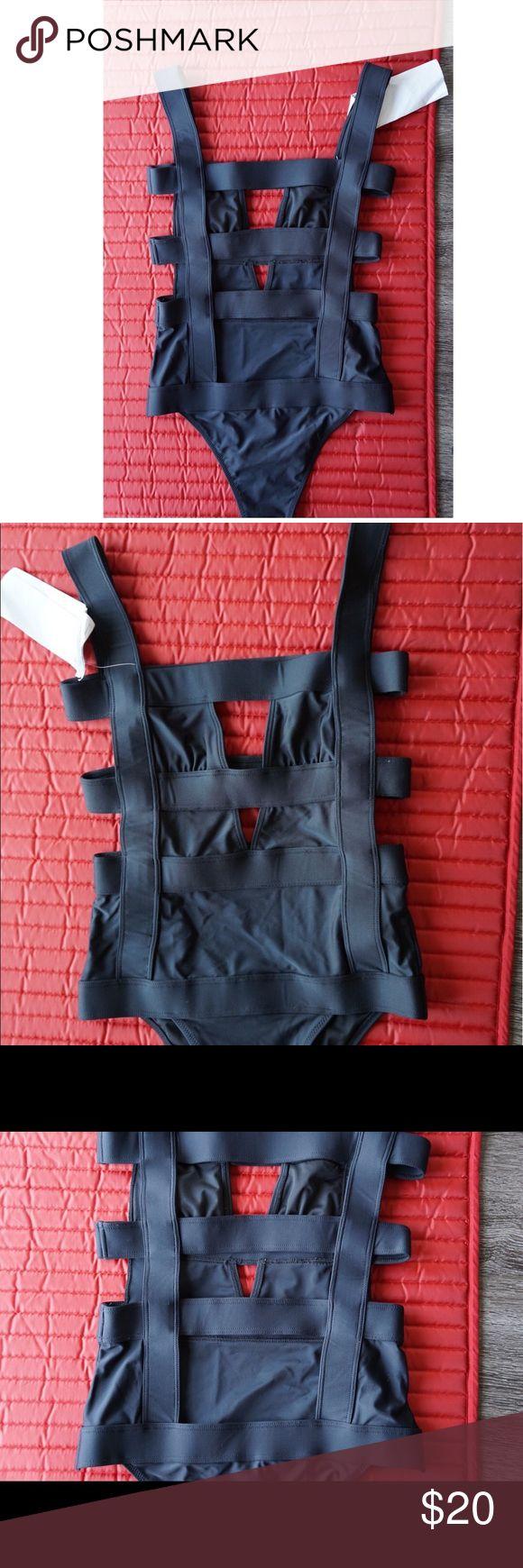 New Black cut out swimsuit SZ 2/4 SM Nasty Gal New black cut out swimsuit from Nasty Gal. Very cute and funky! Nasty Gal Swim One Pieces