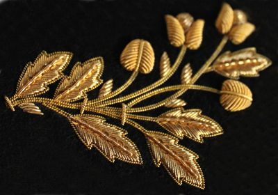 Gorgeous bullion-work. One of the few things we can't do with our embroider machines (not that we couldn't take stylistic hints. . .).