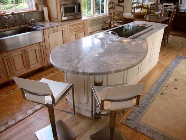 Cuisine avec îlot central et bar arrondi  http://www.homelisty.com/cuisine-avec-ilot-central-43-idees-inspirations/