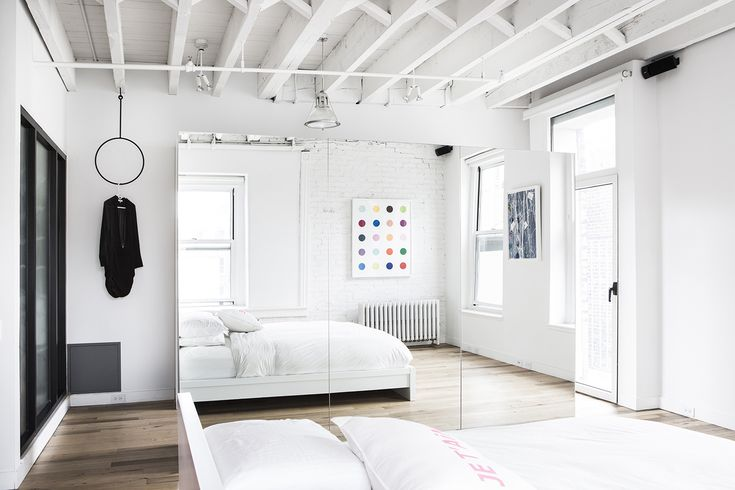 Grand St Loft is a minimalist, all-white interior located in New York City designed byAmee Allsop. It makes great use of small space storage solutions.