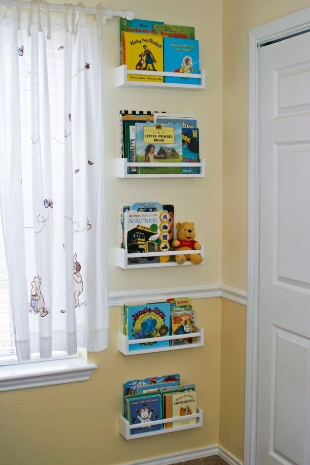 4 dollar IKEA spice racks turned kids book storage - sometimes I don't know which board to pin things on...is this a DIY or a No Place LIke Home pin?