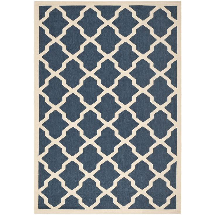 Add comfort to hardwood flooring or cement with this indoor/outdoor area rug from Safavieh. This contemporary navy-and-beige rug is neutral enough to blend into any space, and the polypropylene construction is durable, making it perfect for your patio.
