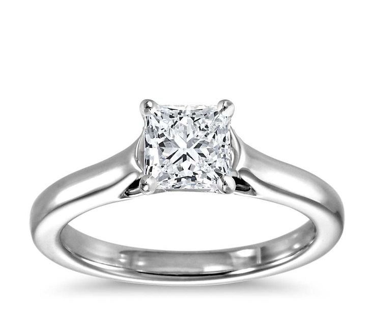 This striking 14k white gold solitaire setting offers a more delicate interpretation of our Trellis Engagement Ring. A narrower shank gently contours to cradle your choice of round, princess or Asscher-cut center diamond with the same classic trellis design.