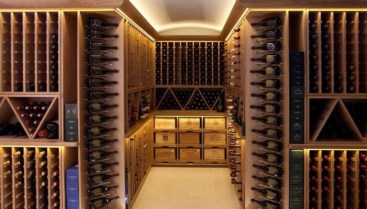 Modern hardwood wine cellar with wooden wine box storage shelving