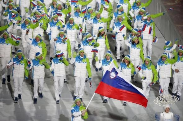 Slovenia's flag-bearer Tomaz Razingar leads his country's contingent during the athletes' parade at the opening ceremony of the 2014 Sochi W...