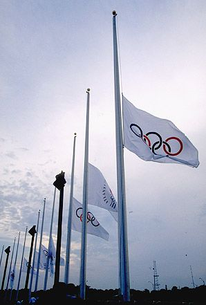 Flags fly at half-mast at the 1996 Atlanta Olympics after two were killed and 111 injured in a bombing for an anti-abortion and anti-gay agenda.