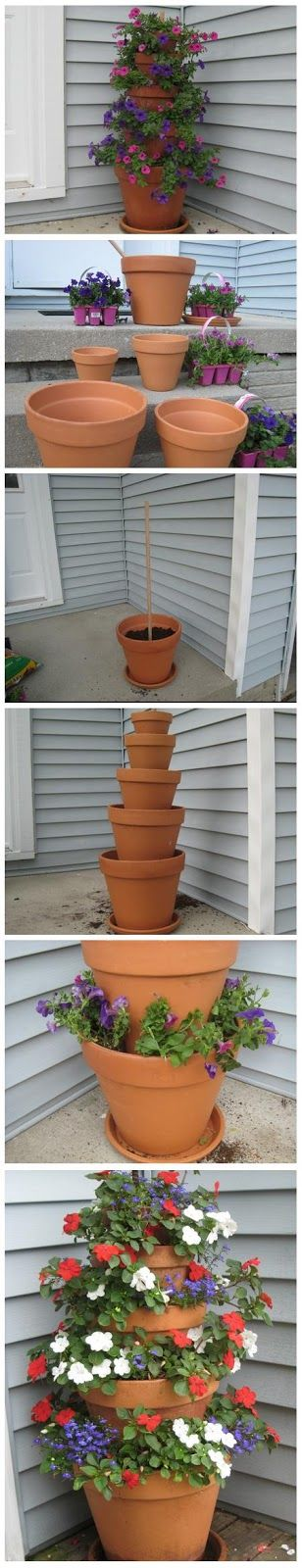 Terra Cotta Pot Flower Tower with Annuals | World In Green  Maybe I could use some of those zillions of pots I have in the backyard to do this!