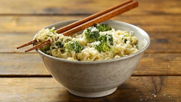 Recipe with video instructions: Magic happens when mac and cheese meets instant ramen. Ingredients: 1 package chicken-flavored instant ramen, 1 cup milk, 1 clove garlic, chopped, Pinch of nutmeg, Mushrooms, spinach or broccoli, 1/4 cup Parmigiano-Reggiano, Freshly ground black pepper, to taste