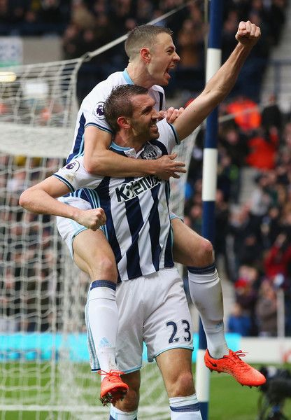 Seamus Coleman of Everton (R) celebrates scoring his sides second goal with Jonny Evans of West Bromwich Albion (L) during the Premier League match between West Bromwich Albion and AFC Bournemouth at The Hawthorns on February 25, 2017 in West Bromwich, England.