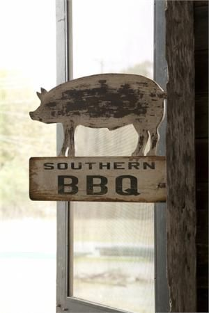 Southern BBQ is known for its mouth-watering flavors and down-home country style. Our vintage style Southern BBQ Pig Sign captures that essence. Inspired by antique signs from barbecue eateries throughout the south, this double-sided sign makes a great party decoration for your next BBQ or let it add relaxed charm to your farmhouse kitchen. Made of wood with metal bracket for hanging. Not recommended for outdoor use.