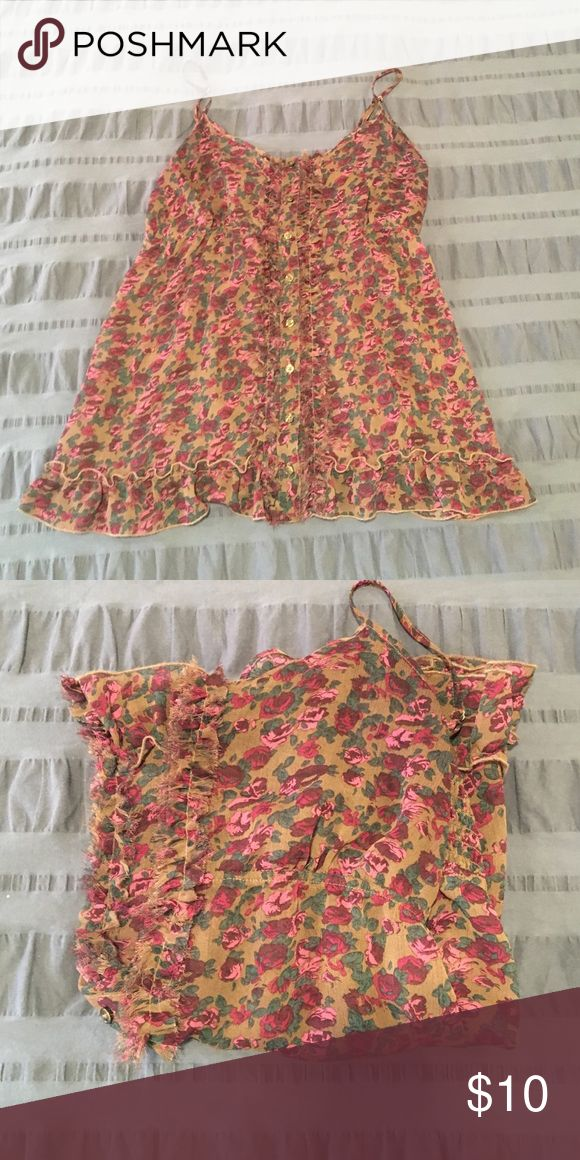 Express Sheer Floral Tank Sheer floral Tank with ruffle hem and ruffle/fringe detail down the front. I love the longer length and usually wore it over a black camisole. Great condition. Express Tops Tank Tops
