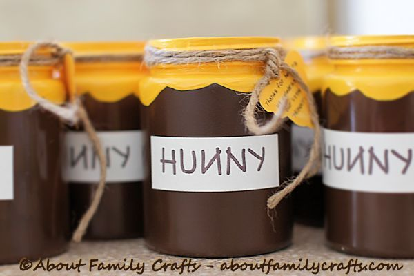 Winnie the Pooh HUNNY Pot - Discover how easy it is to make this adorable Winnie the Pooh themed craft that makes a fun party favor@Winnie the Pooh HUNNY Pot Favor ! (http://aboutfamilycrafts.com/winnie-the-pooh-hunny-pot-favor/)