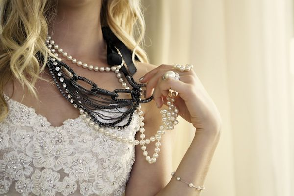 bride holding chain and pearl necklace - wedding photo by top Orange County, California wedding photographers D. Park Photography